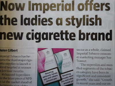 """A photo of a newspaper article with the title: """"Now Imperial offers the ladies a stylish new cigarette brand""""."""